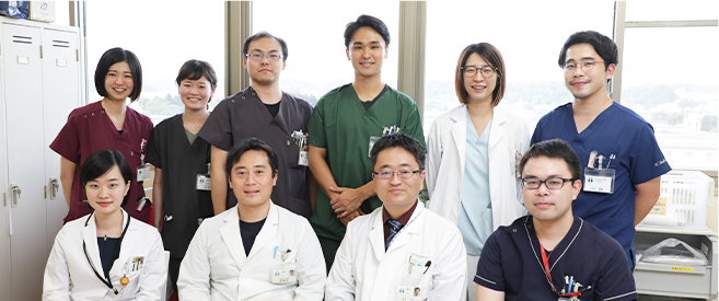 望月 仁志氏と診療科の医師達